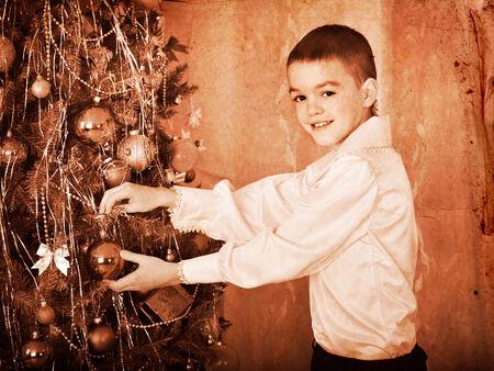 Child decorate on Christmas tree. Black and white retro. Stock Photo - 24177052