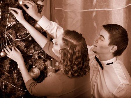 Couple on party near Christmas tree. Black and white retro. photo