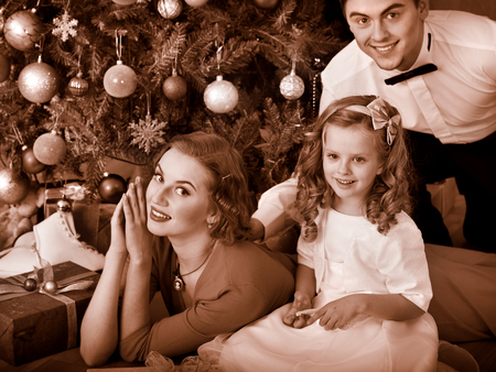 Family with children  dressing Christmas tree. Black and white retro. photo