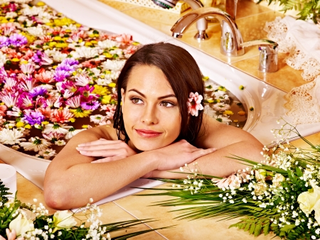 Woman relaxing at water spa. photo