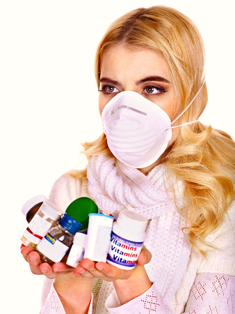 Young woman having flu takes pills. Isolated. Stock Photo - 25070443