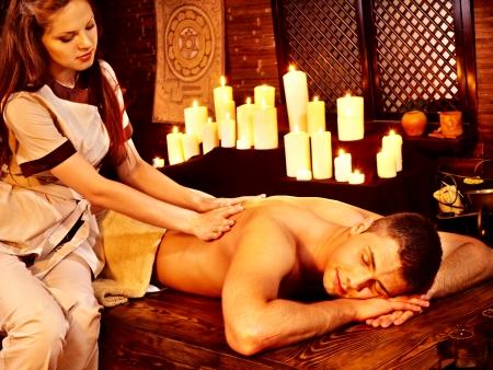 panchakarma: Young man having oil Ayurveda spa treatment. Stock Photo