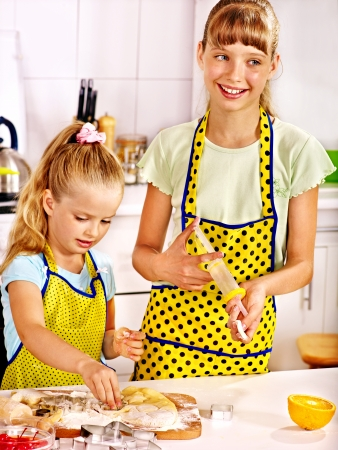 rollingpin: Child with rolling-pin at kitchen. Stock Photo