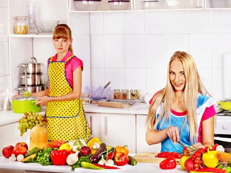 Mother and daughter cooking food at kitchen. Stock Photo - 25073899