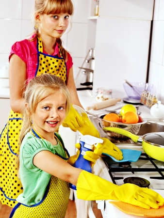 housewife gloves: Children cleaning  kitchen. Housekeeping.