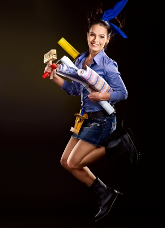 Builder woman with wallpaper. Fashion, photo