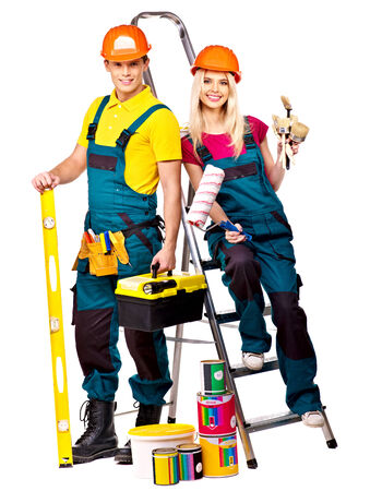 Couple builder  with construction tools  Isolated  photo