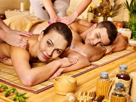 Man and woman relaxing in bamboo spa. photo