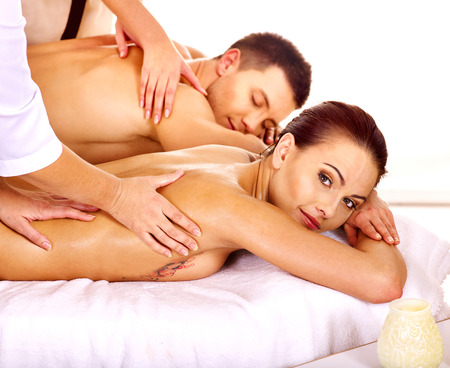 Man and woman relaxing in spa. Isolated. photo