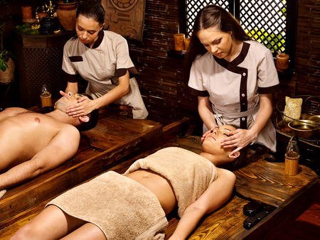 bamboo leaf: Couple  having oil Ayurveda spa treatment. Stock Photo