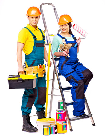 Couple builder  with construction tools. Isolated. photo
