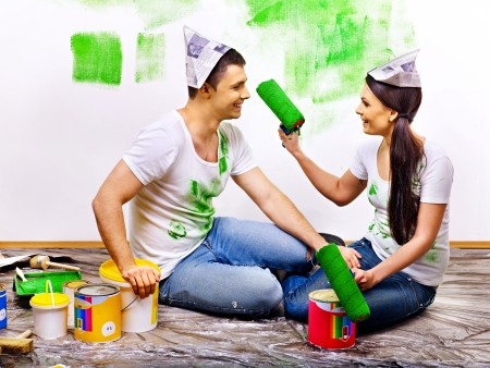 Happy family paint wall at home. Stock Photo - 25226340