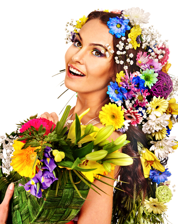 Face of woman with make up and flower. Isolated. photo