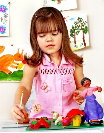 nurser: Little girl  moulding of plasticine .