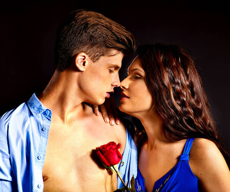 Beauty couple with rose flower  photo
