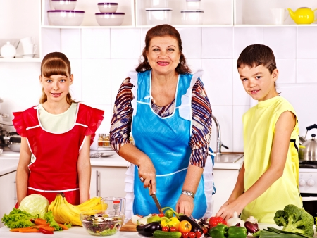 Family with grandmother and child cooking at kitchen  photo
