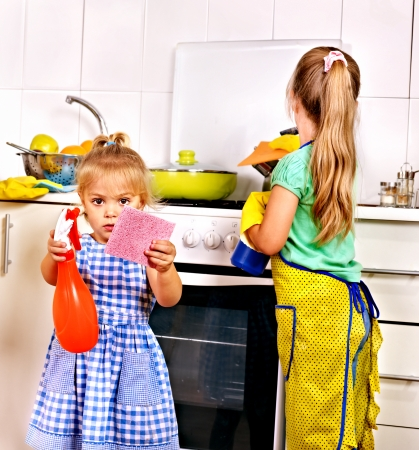 dirty dishes: Children cleaning  kitchen. Housekeeping.