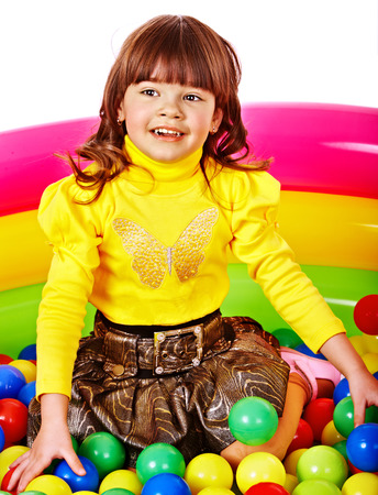 playcentre: Happy child in group colourful ball. Isolated. Stock Photo