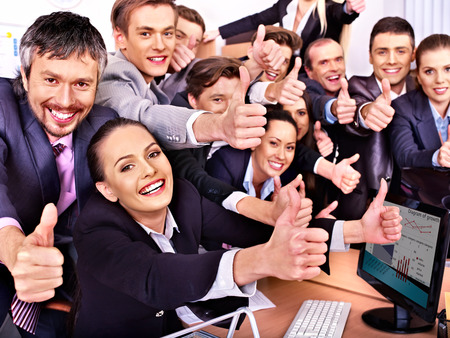 employee: Happy group business people thumb up  in office.