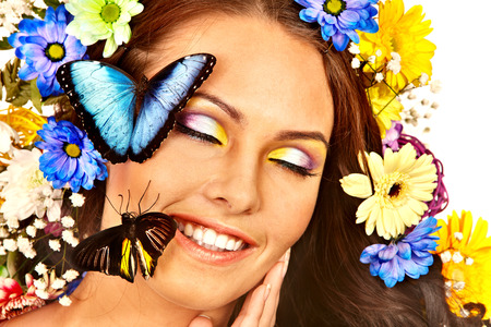 Woman with  flower and  butterfly. Isolated.