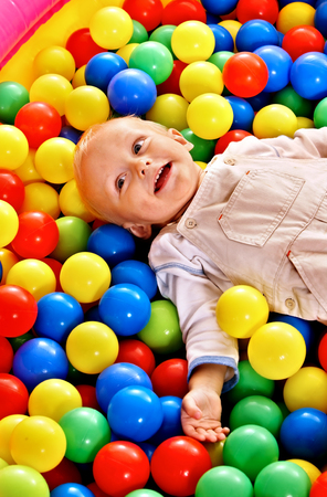 Little boy in colored ball. photo