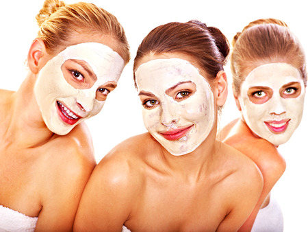 beauty parlour: Group women with  facial mask in beauty spa.