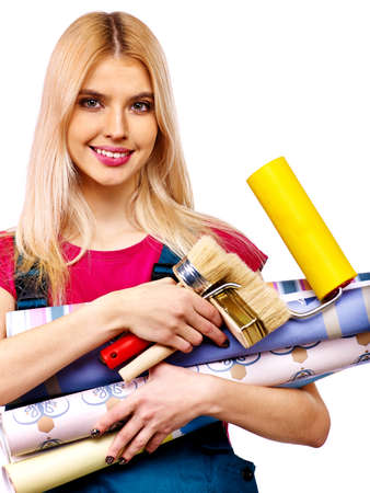 Builder woman with roll wallpaper. Isolated. photo