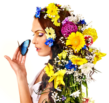 Woman with  flower and  butterfly. Isolated. photo