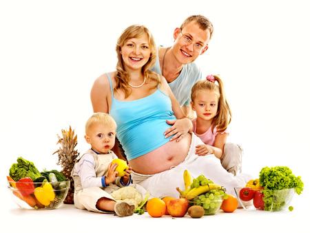 Happy family with pregnant woman and kid preparing food. Isolated. photo