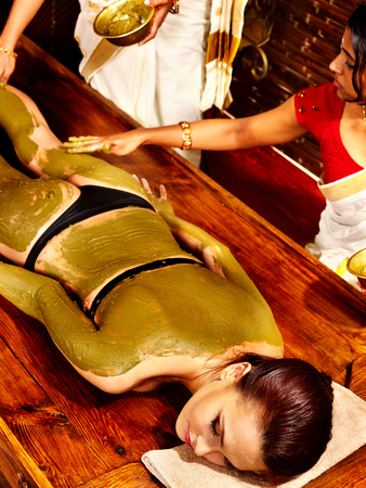 panchakarma: Young woman having body Ayurveda spa massage.