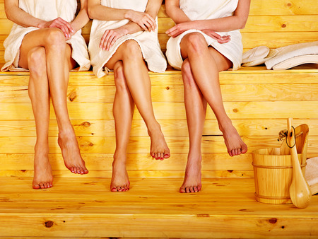 sauna: Young woman in sauna. Stock Photo