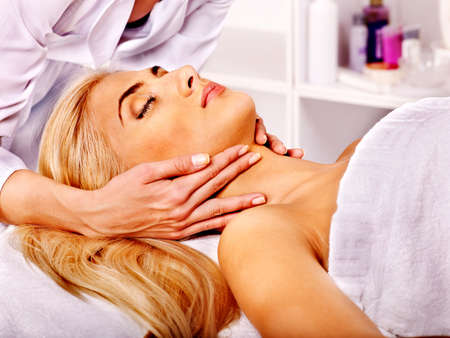 head massage: Blond woman getting head massage at spa.Woman getting  facial massage .