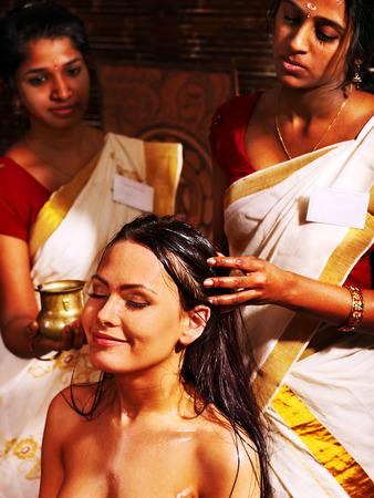 window treatments: Young woman having head ayurveda spa treatment.