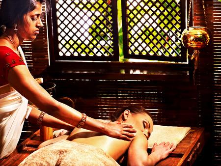 panchakarma: Young woman having oil Ayurveda spa treatment. Stock Photo