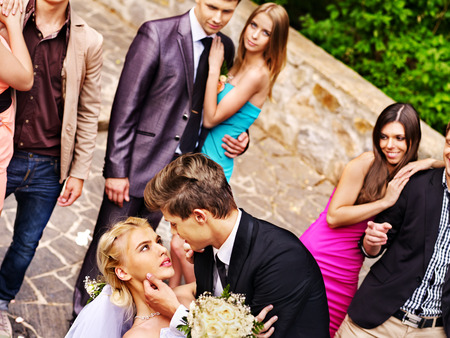 Groom kissing bride . Outdoor. photo