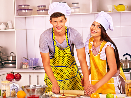Young happy cook cooking at kitchen. photo