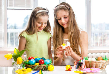Children paint Easter eggs at school. photo