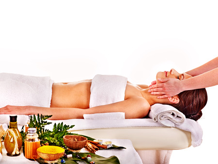 Young woman getting spa head therapy . Isolated.