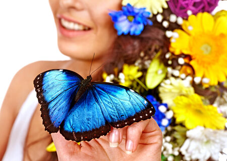 Butterfly on hand. Isolated. Stock Photo