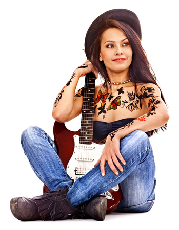 sexy guitar: Young woman with tattoo playing guitar. Stock Photo