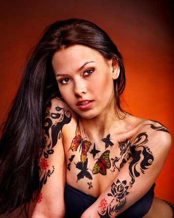 body art: Young woman with body art . Studio shot. Stock Photo