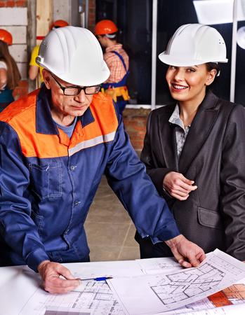 Business woman in builder helmet indoor. photo