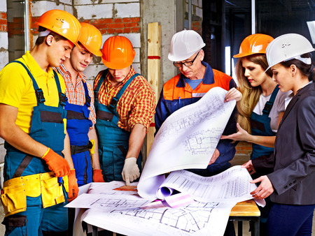 Business group people in builder helmet indoor. photo