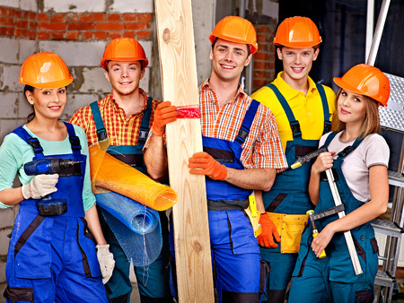 millwright: Happy group people in builder uniform.
