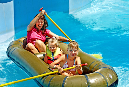 Family with children  ride  rubber boat at  swimming pool . photo