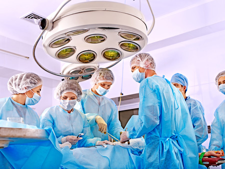 Team surgeon at work in operating room. Imagens - 27460716