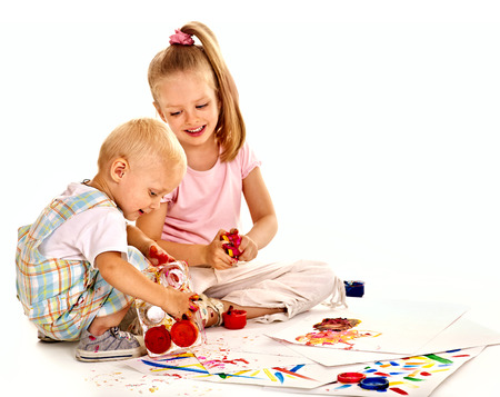 child finger: Happy family with child painting by finger paint.
