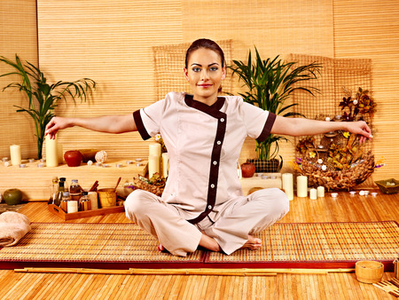 Bamboo massage at spa and woman. Luxury relaxation. photo