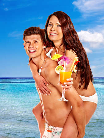 Couple with cocktail at Hawaii wreath beach. Summer outdoor. Stock Photo - 27461751