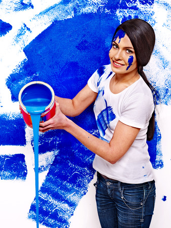 Happy woman paint wall at home. Stock Photo - 27461892